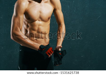 Athletic man with muscular muscular torso training confidence attractive