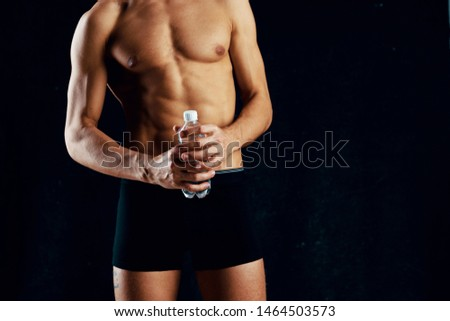 Athletic man with muscular torso workout fitness workout exercise