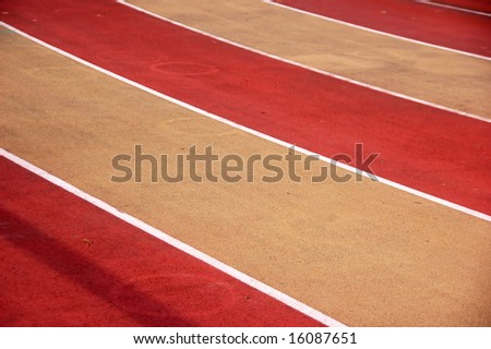 Athletic red and white striped running track