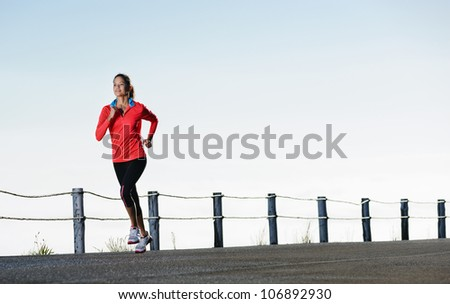 Athletic runner training alone on a road outdoors for marathon and fitness. healthy wellness exercise panorama with copyspace.