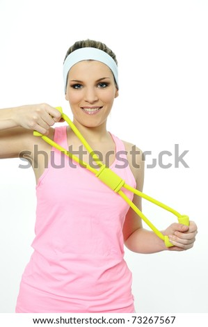 athletic woman doing gymnastic exercises with an elastic fitness