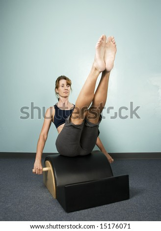 Athletic Woman Exercising and Balancing on Gym Equipment