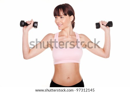 Athletic woman holding two dumbbells in her hands above her shoulders during a workout - stock photo