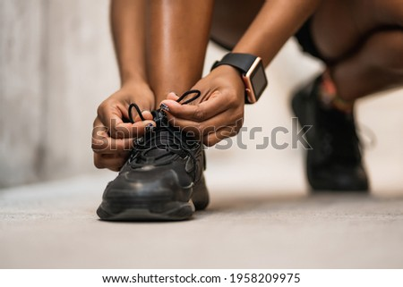Athletic woman tying her shoelaces. Stock foto ©
