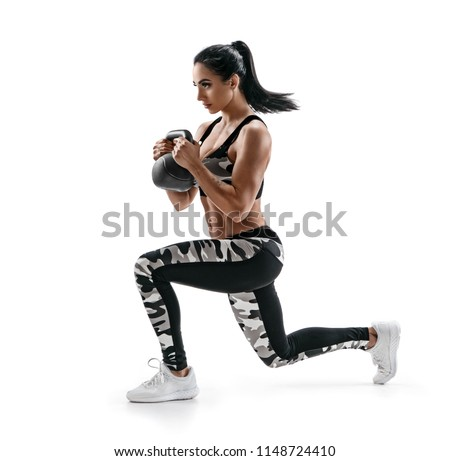 Athletic woman with kettlebell doing a lunges. Photo of latin woman in silhouette isolated on white background. Strength and motivation. Side view.