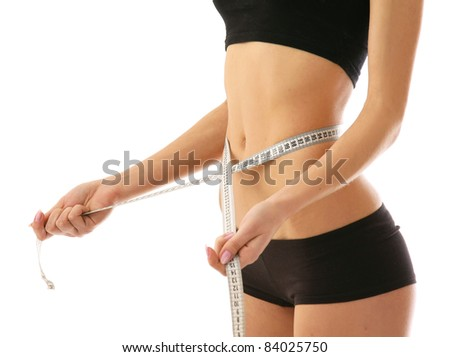 Athletic woman with measure tape isolated on white