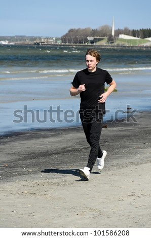 Athletic young male running on the beach