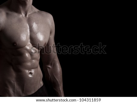 athletic young man on black background - much space for own text