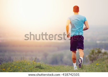 Athletic young man running in the nature. Healthy lifestyle #418742101