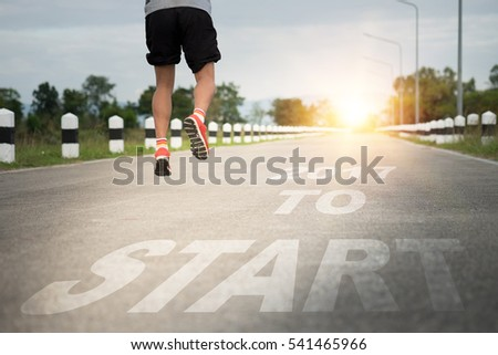 Athletic young man running on the road with text 2017 year, Start to new year. Happy new year concept.