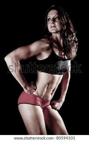 Athletic Young Woman Flexing Muscles