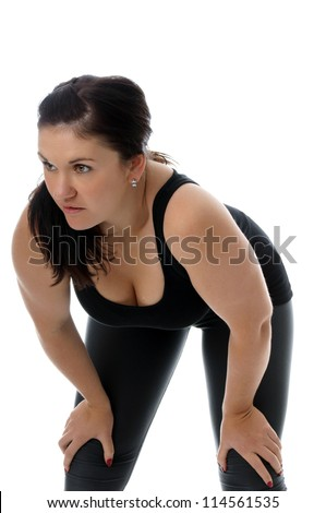 athletic young woman in fitness clothes / sporty woman