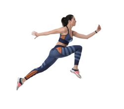 Athletic young woman running on white background, side view