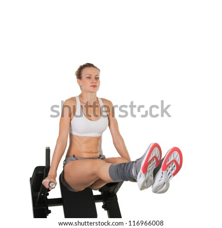 Athletic young woman training on exerciser isolated on white