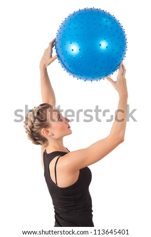 Athletic young woman with blue ball isolated on white