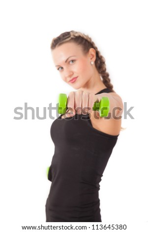 Athletic young woman with dumbbell isolated on white