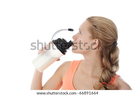 athletic young woman with protein shake bottle. Isolated on white background