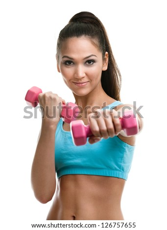 Athletic young woman works out with pink dumbbells, isolated on white