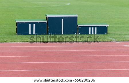 Athletics podium on grass in the stadium #658280236