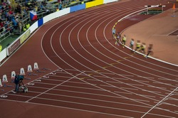 Athletics professional race on long distance. African Athletes are running on stadium before olympic game in Rio.