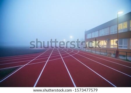 Athletics red Track in morning mist
