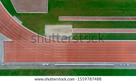 Athletics running track. Abstract aerial view looking down onto an athletics running track set