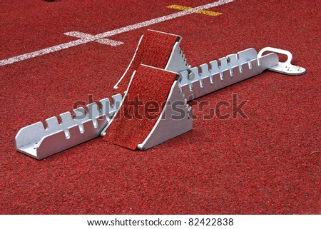 Athletics Starting Blocks on a red running track in a stadion