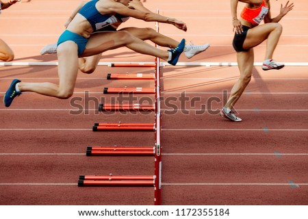 athletics women 100 metres hurdles running in stadium