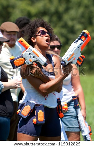 ATLANTA, GA - JULY 28:  Unidentified people take part in a water gun battle called the Fight4Atlanta, a squirt gun fight between dozens of locals at Freedom Park on July 28, 2012 in Atlanta.