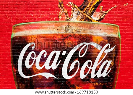 ATLANTA, GA, USA - DECEMBER 04: A glass full of Coca Cola painted in a old wall in Atlanta, Georgia on dec 04, 2013. Atlanta is the home of Coca Cola.