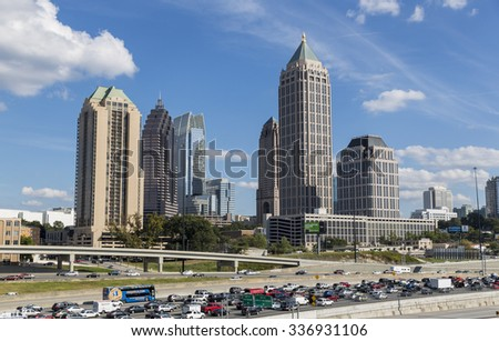 ATLANTA, GEORGIA/USA - OCTOBER 11, 2014: Atlanta skyline and Interstate 75 and 85. The history of skyscrapers in Atlanta began with the completion in 1892 of the Equitable Building.