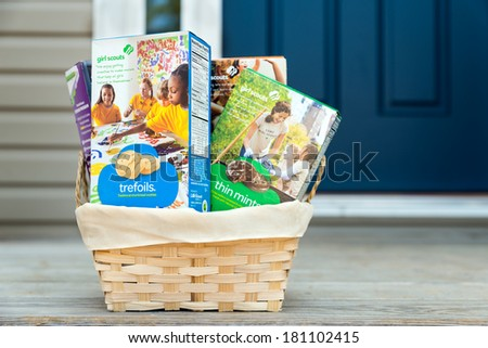 ATLANTA - MARCH 9, 2014: Assortment of packaged Girl Scout cookies in basket delivered on front porch.
