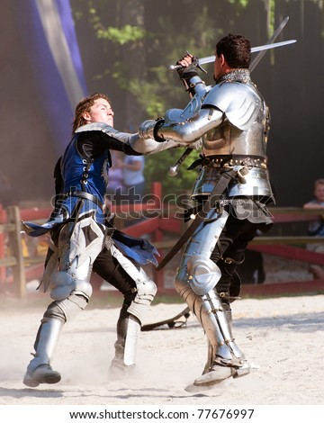 ATLANTA - MAY 21: Knights duel during the annual Renaissance Festival in Atlanta on May 21, 2011. The festival is a popular annual tourist attraction in the Southeast.