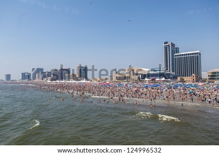 ATLANTIC CITY - AUGUST 11: View on Atlantic City New Jersey beach full of people on August 11, 2012. Atlantic City is considered the gambling capital of the East Coast.