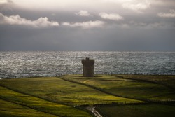 Atlantic ocean and medieval signal tower on the shore of Malin Beg, small Gaeltacht village south of Glencolumbkille, County Donegal, Ireland