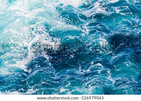 Atlantic ocean with blue water on a sunny day. Waves, foam and wake caused by ship in the sea, wave rippled effect filtered image for creative graphic design concept, water background, website banner