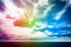 Atlantic Ocean with dramatic colorful sky and clouds. Cruising along Islands, view from cruise ship, image with rainbow filter effect for tourism business concept, travel blogs, creative photo website