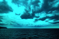 Atlantic Ocean with dramatic colorful sky and clouds. Cruising along Islands, view from cruise ship, image with color filter effect for tourism business concept, travel blogs, creative photo website