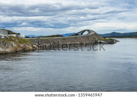 Atlantic Road with the famous Storseisundet Bridge popular site to film automotive commercials, More og Romsdal, Norway #1359465947