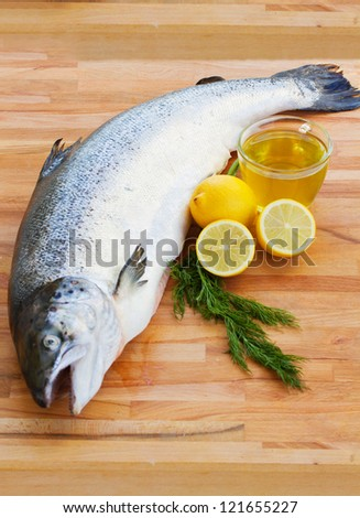 Atlantic Salmon whole on wooden background