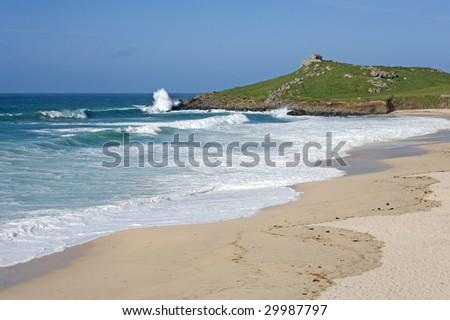 Atlantic sea breaks on Porthmeor beach in St. Ives, Cornwall UK.