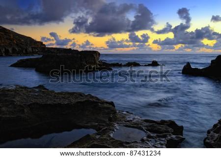 Atlantic sunset over Canary  Island, Lanzarote, El Golfo bay