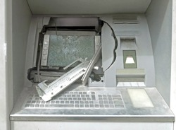 ATM machine with broken glass following a robbery