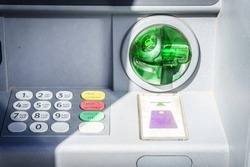 ATM or cash machine in the stone wall. Fast and convenient way of cash-out and payments. Bank operations with accounts using plastic card