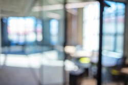 Atmosphere around office blur background with bokeh. Abstract blurred office interior room. blurry working space with defocused effect. use for background or backdrop in business concept