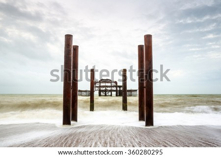 Atmospheric and Moody Long Exposure Photograph of the Ruins of the old Brighton West Pier at Brighton, East Sussex, England, UK #360280295
