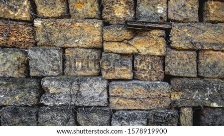 atmospheric background texture of an old brick wall #1578919900