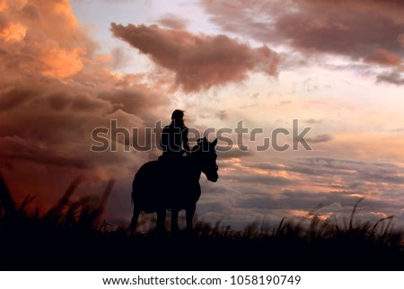 Atmospheric, dramatic background with horse and girls silhouette on colorful storm cloudy sky. Scene of horseback, riding horse on peak in moment of weather change. #1058190749