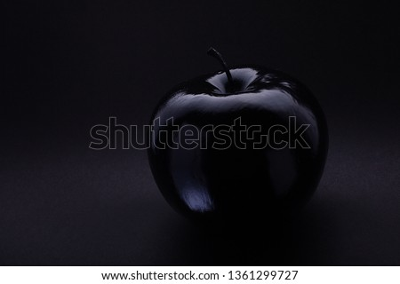 Atmospheric monochrome Art black apple on a black background, black on black Concept Mystical, Magical, Fairy-tale #1361299727