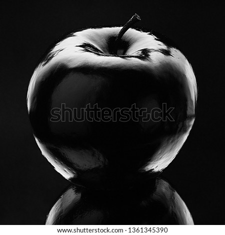 Atmospheric monochrome Art black apple on a black background, black on black Concept Mystical, Magical, Fairy-tale #1361345390
